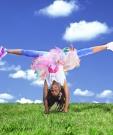 happy kid doing cartwheel in summer